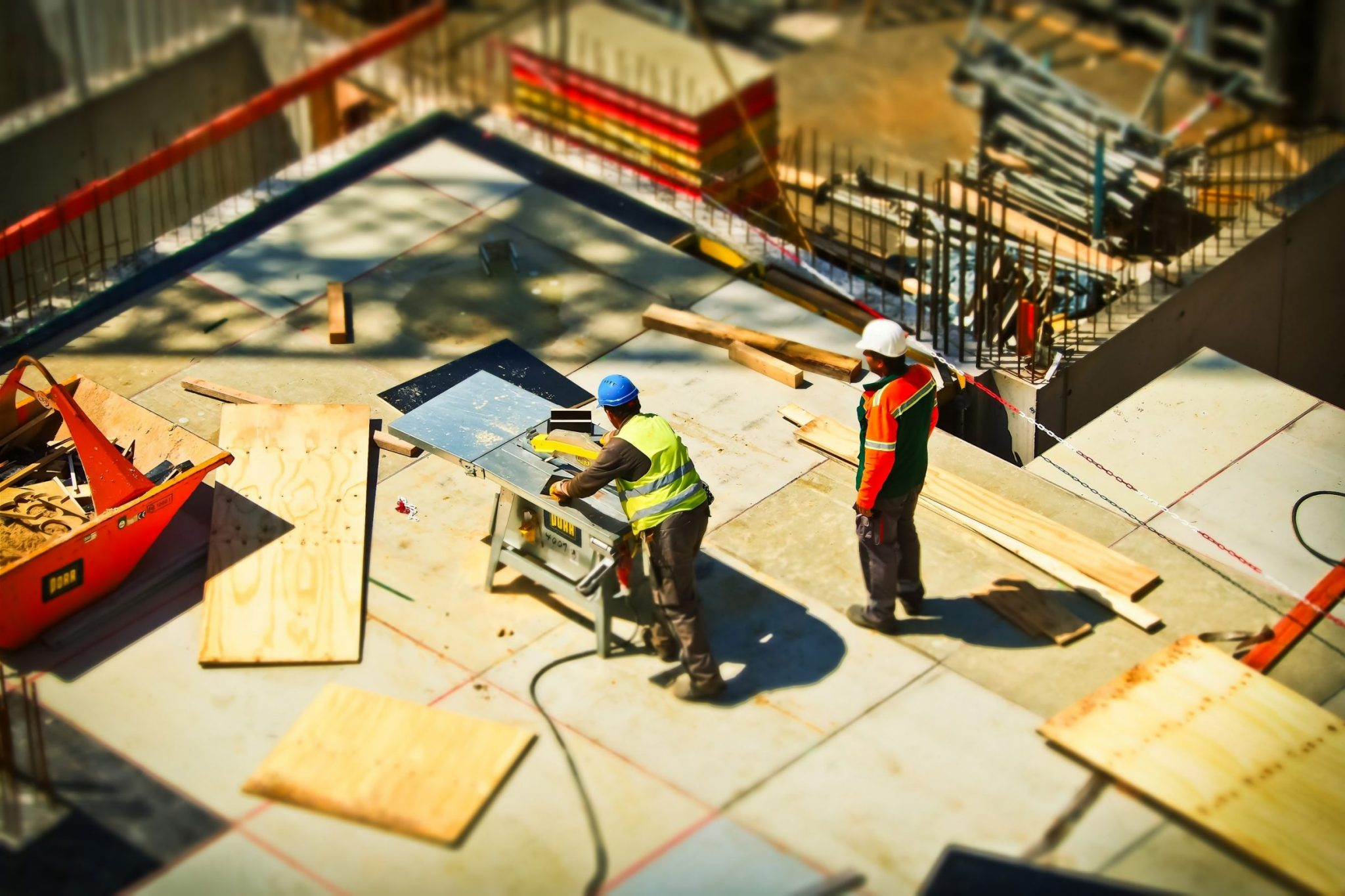 A birds eye image of two construction workers.