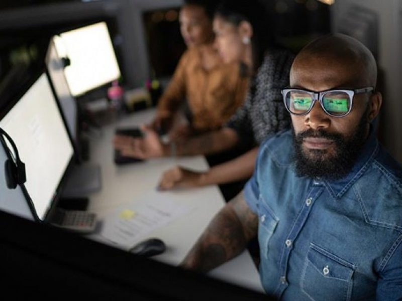 EDGE UP: Man using a computer