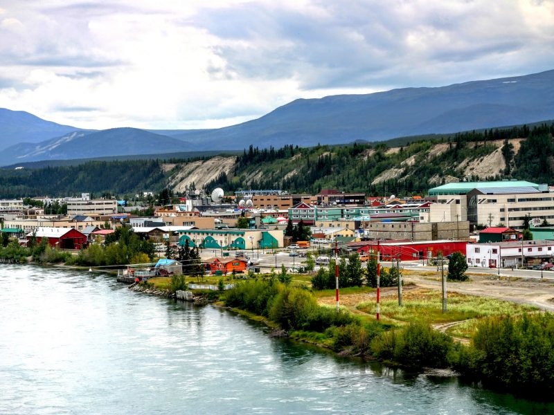 Yukon Whitehorse town near the river and mountain.
