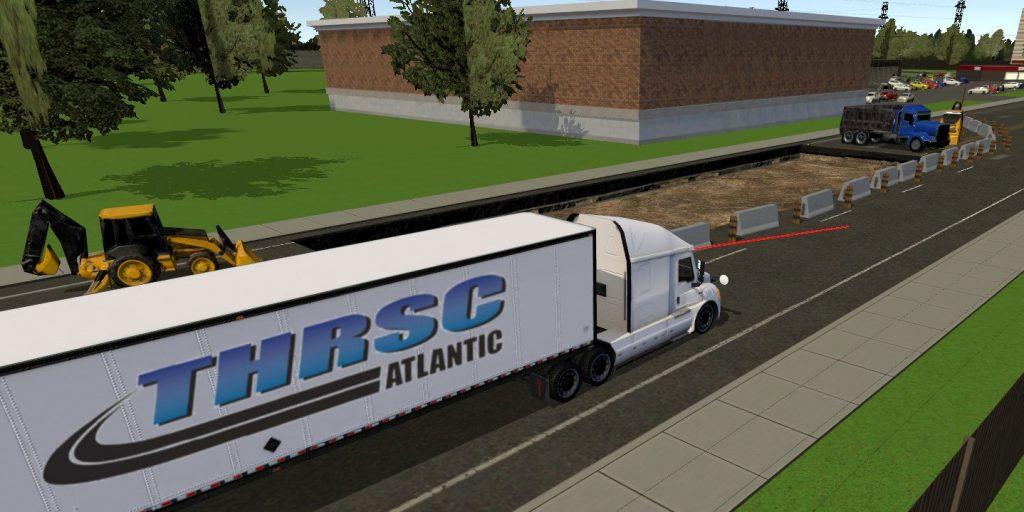 Birds-eye view screenshot from simulator showing truck being driven