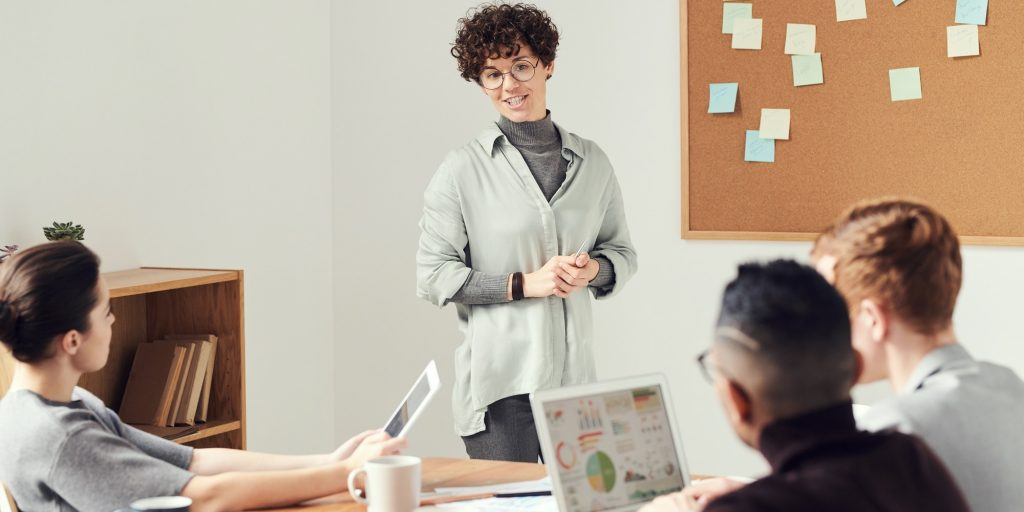 Woman leading session with coworkers