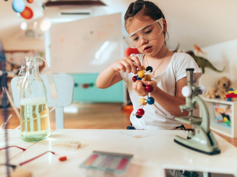 Child playing with molecule
