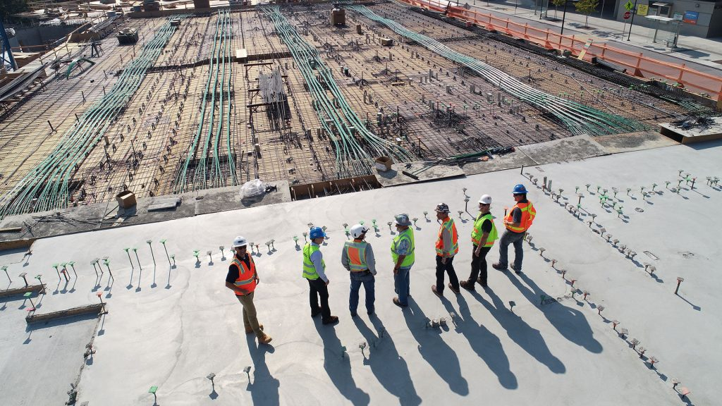 Aerial view of construction workers looking at their work-site