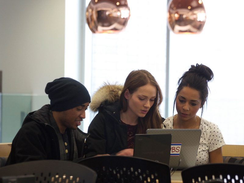 Students working together on their laptops