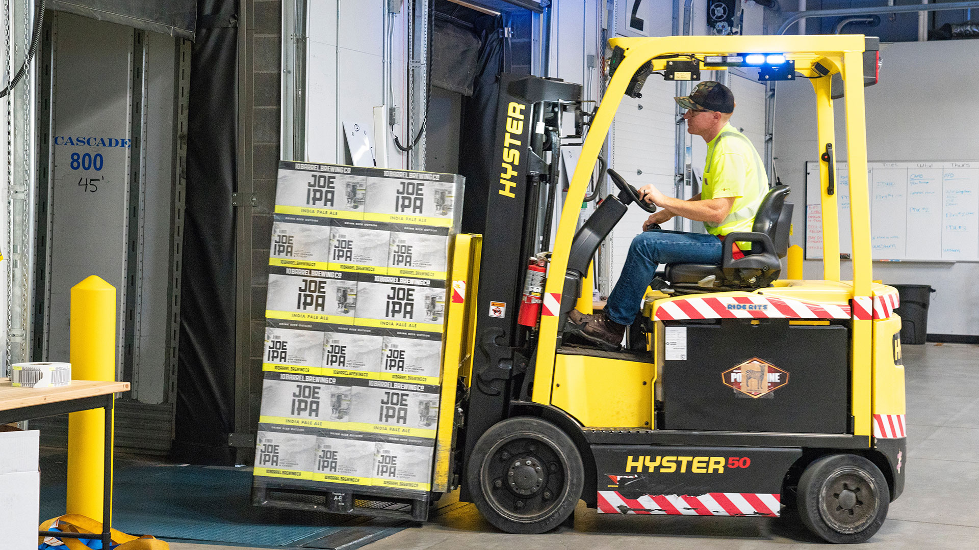 Forklift operator moving a pallet of goods