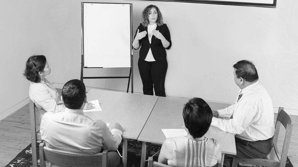 Person giving a whiteboard presentation to a group