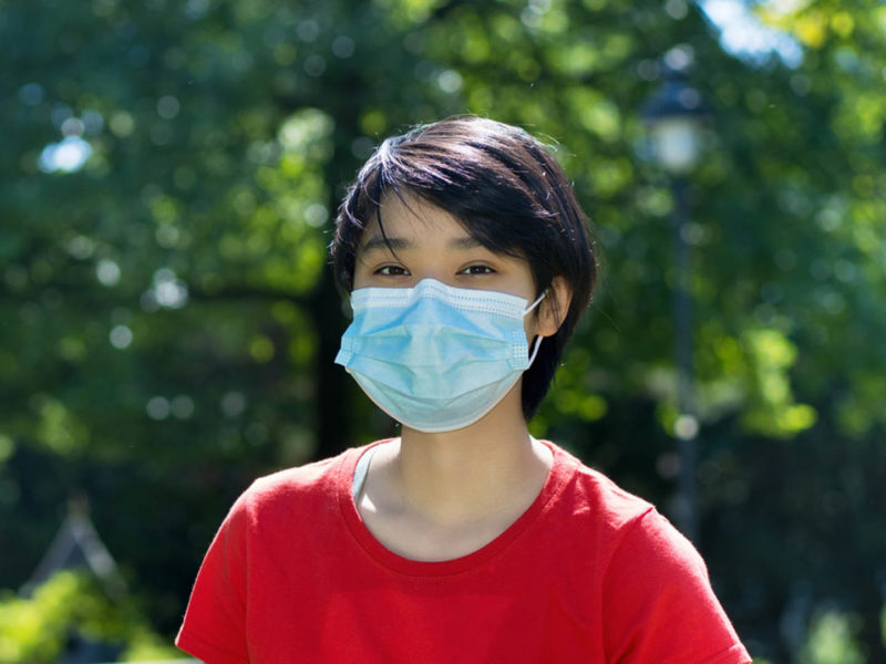 Student with face mask at campus of university
