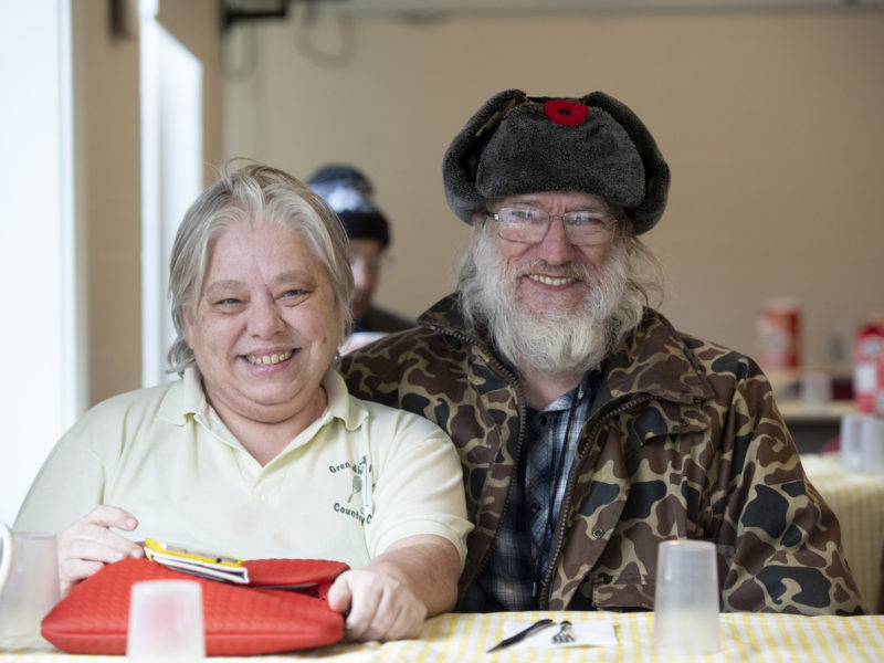 Image of individuals smiling at the camera.