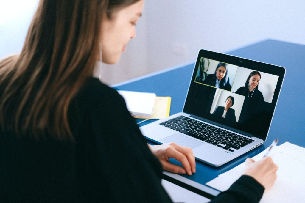 Person attends a video chat on a laptop