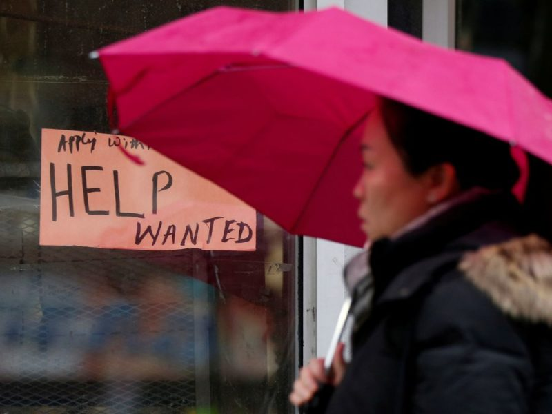 A person walks past a help wanted sign in Ottawa.