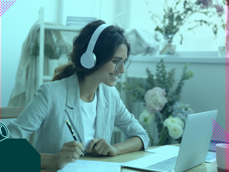 Person working from home at a desk, laptop and headphones